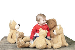 Toddler with lots of teddy bears Stock Photography