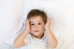 Toddler is lying in bed ready to sleep. Asian boy 3 years going to sleep at home. sleepy eyes royalty free stock image