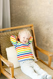 Toddler lying in the chair Royalty Free Stock Image