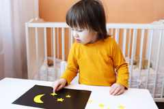 Toddler made applique of paper details. Night sky and stars Stock Photography
