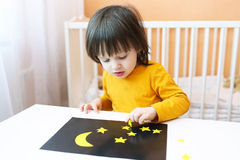 Toddler made night sky and stars of paper details Royalty Free Stock Photo