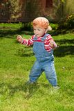 Toddler make first steps in the garden Stock Photos