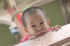 Toddler makes duck face Royalty Free Stock Photography