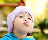 Toddler making face Stock Photography