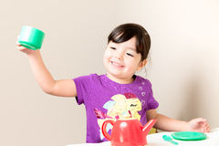 Toddler Making a Toast Royalty Free Stock Image