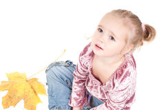 Toddler with maple leaves Royalty Free Stock Image
