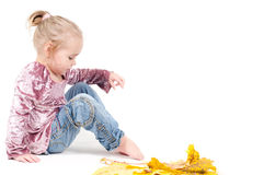 Toddler with maple leaves Stock Photo