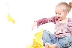 Toddler with maple leaves Stock Photography