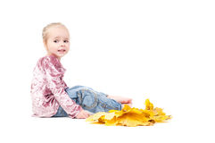 Toddler with maple leaves Royalty Free Stock Photos