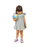 Toddler meditating and holding globe Stock Image
