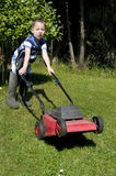 Toddler mowing lawn Stock Photography