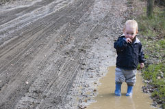 Toddler in the mud Stock Photos