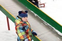 Toddler near slide Stock Image