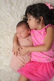 Toddler and Newborn Baby Sister Portrait stock photo