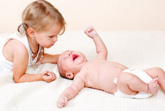 Toddler and newborn brother Royalty Free Stock Photos