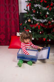 Toddler opening Christmas gifts Stock Images