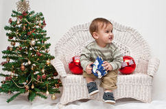 Toddler opening Christmas present Stock Photos