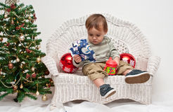 Toddler opening Christmas present Royalty Free Stock Image