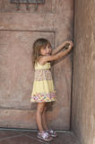 Toddler opening door Stock Images