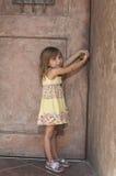 Toddler opening door stock images