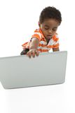Toddler opening laptop Stock Images