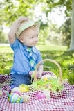Toddler Outside Holding Easter Eggs Tips His Hat Royalty Free Stock Photo