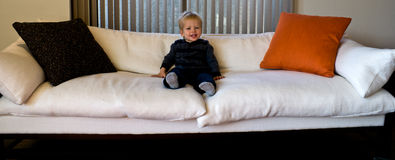 Toddler on an oversized sofa Royalty Free Stock Photos