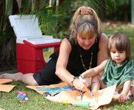 Toddler Painting. Woman painting with toddler outside royalty free stock images