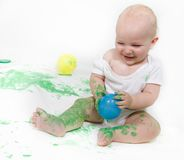 Toddler painting over white Stock Photo