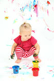 Toddler painting on white paper Stock Photo