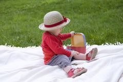 Toddler palying outdoors with memo cards Royalty Free Stock Images