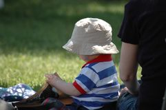 Toddler in park. With hat Royalty Free Stock Photo