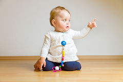 Toddler on a parquet floor Stock Photo
