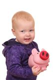 Toddler with piggybank Royalty Free Stock Photos