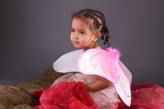 A toddler in Pink fairy wings royalty free stock photography