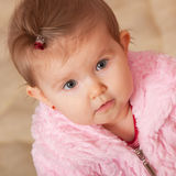 Toddler in pink fur coat Royalty Free Stock Photography