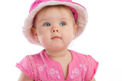 Toddler in pink hat. Lovely curious toddler in pink hat royalty free stock photo