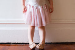 Toddler in pink tutu (cropped). Toddler in pink tutu and ballet shoes standing in vintage hallway (cropped royalty free stock photos