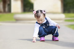 Toddler pirl playing outdoor stock photos
