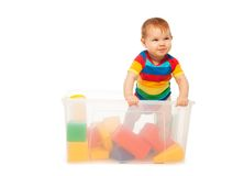 Toddler play in basket with blocks Royalty Free Stock Photos