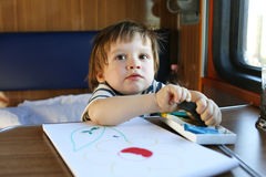 Toddler with playdough on train Royalty Free Stock Images