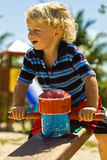 Toddler at the playground. Toddler laughing and playing at the playground Stock Image