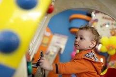 Toddler playing with amusement machine Royalty Free Stock Photo