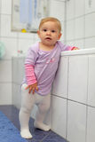 Toddler playing in a bathroom Royalty Free Stock Photo