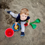 Toddler playing on the beach Stock Images