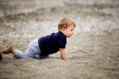 Toddler playing on the beach Royalty Free Stock Images