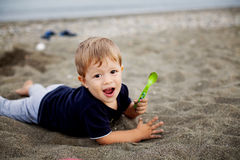 Toddler playing on the beach Royalty Free Stock Photo