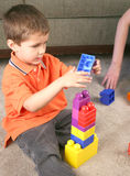 Toddler playing with blocks Stock Image