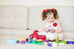 Toddler playing with blocks stock photography