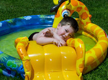 Toddler playing in blow up pool Royalty Free Stock Photo